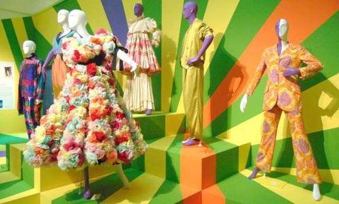 Green, Dress, Costume design, One-piece garment, Mannequin, Day dress, Fashion design, Retail, Sculpture, Boutique,