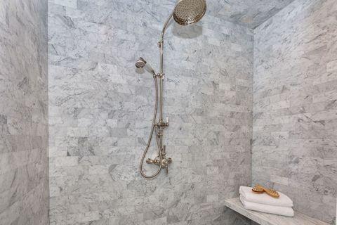 Wall, Plumbing fixture, Metal, Beige, Still life photography, Woodwind instrument, Shower head, Tile, Silver, Bathroom,