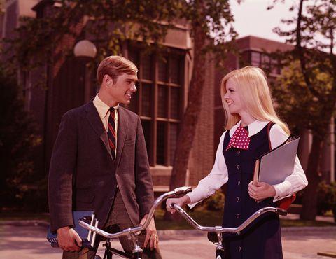 Bicycle, Bicycle handlebar, Coat, Bicycle frame, Suit, Bicycle wheel, Bicycle accessory, Blazer, Tie, Conversation,