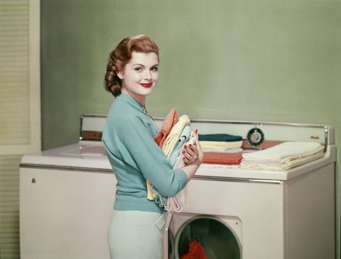 Tooth, Cabinetry, Major appliance, Coquelicot, Plumbing fixture, Homemaker, Tap, Red hair, Bathroom sink, Washing machine,