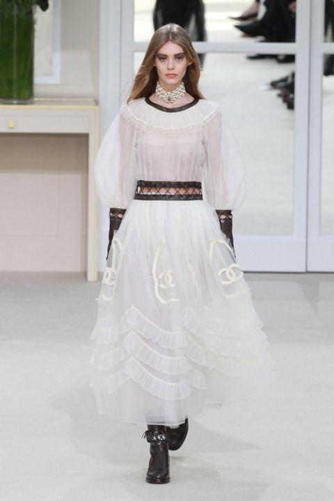 Sleeve, Shoulder, Dress, White, Floor, Style, Formal wear, Fashion model, Flooring, Gown,