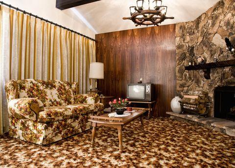 Wood, Lighting, Room, Interior design, Floor, Living room, Ceiling fixture, Flooring, Couch, Wall,
