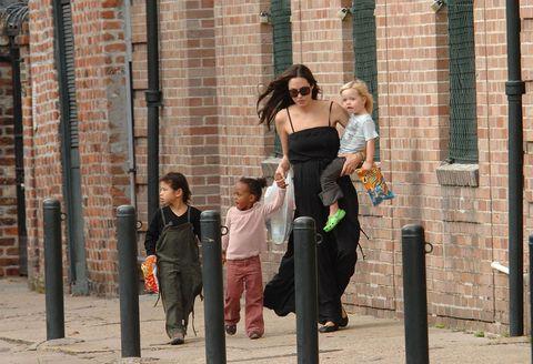 Brick, Standing, Dress, Brickwork, Waist, Street fashion, Walking, Strapless dress, Day dress, One-piece garment,