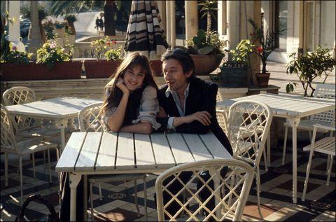 Table, Furniture, Outdoor furniture, Outdoor table, Hat, Chair, Flowerpot, Restaurant, Houseplant, Tie,