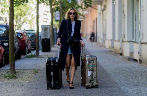 Eyewear, Glasses, Vision care, Sunglasses, Human body, Outerwear, Street fashion, Street, Musical instrument, Bag,
