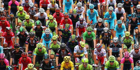 Helmet, Green, Personal protective equipment, Sports equipment, Sports gear, Sportswear, Endurance sports, Competition event, Team, Racing,