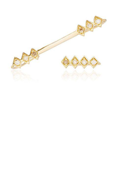 "<p><strong>Azlee</strong> ear cuff, €1550, <a href=""https://www.modaoperandi.com/azlee-fw15/18k-gold-and-diamond-single-burst-ear-wire-and-rod-set"" target=""_blank"">modaoperandi.com</a>. </p>"