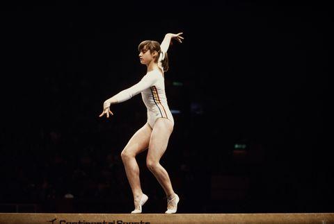 """<p>Romanian Nadia Comenci truly stole the show during the 1976 Olympics—she was awarded the first perfect 10.0 score ever in the Games and then proceeded to get an insane *seven more* perfect 10's during the competition. At the same time, ponytails also made their play during the '76 games, and have become a staple ever since. The slicked-back style clearly makes the most sense for competitors, but up until the '70s, athletes were still abiding by """"ladylike"""" styles while they competed—thankfully the freedom of the '70s also ushered in more sensible competition styles. </p>"""
