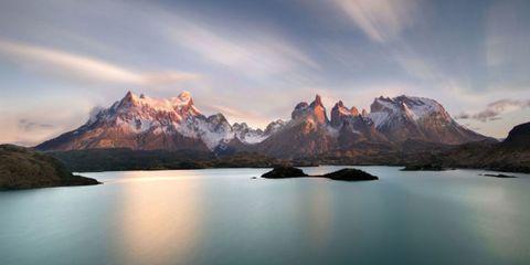 Sky, Mountainous landforms, Natural landscape, Mountain range, Water resources, Cloud, Landscape, Mountain, Rock, Reflection,