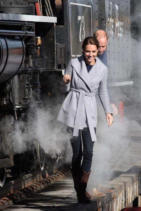 Outerwear, Standing, Denim, Steam engine, Street fashion, Boot, Rolling stock, Train, Locomotive, Railway,