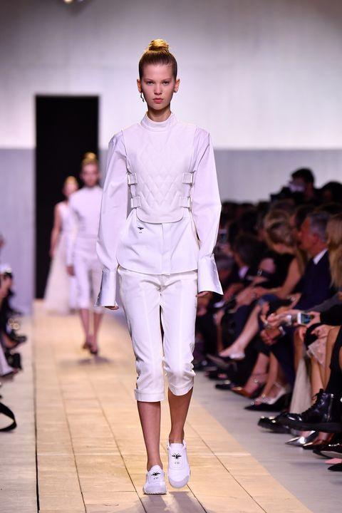 Clothing, Footwear, Fashion show, Leg, Runway, Event, Shoulder, Joint, Outerwear, Human leg,