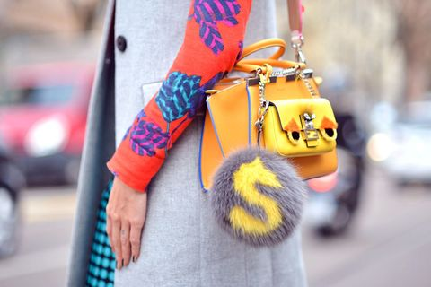 Street fashion, Orange, Electric blue, Bag, Bicycles--Equipment and supplies, Bicycle, Glove, Bicycle handlebar, Rolling, Sweater,