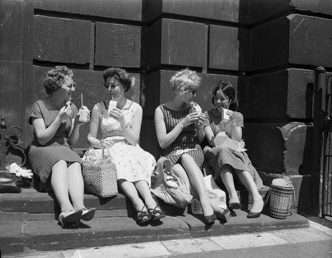 Clothing, Leg, Monochrome, Human body, Human leg, Sitting, Photograph, Monochrome photography, Dress, Black-and-white,