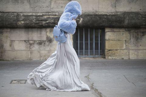 Costume accessory, Concrete, Costume, Sculpture, Costume design, Natural material, Wedding dress, Haute couture, Brick,