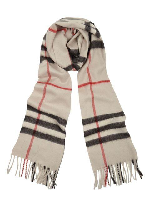 Textile, Pattern, Wrap, Costume accessory, Beige, Fur, Stole, Hood, Costume design, Costume,