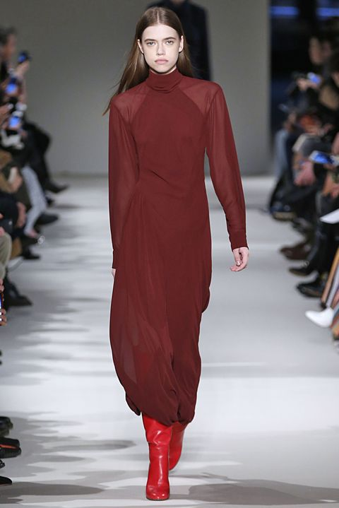 Fashion show, Sleeve, Event, Shoulder, Red, Joint, Runway, Fashion model, Style, Dress,