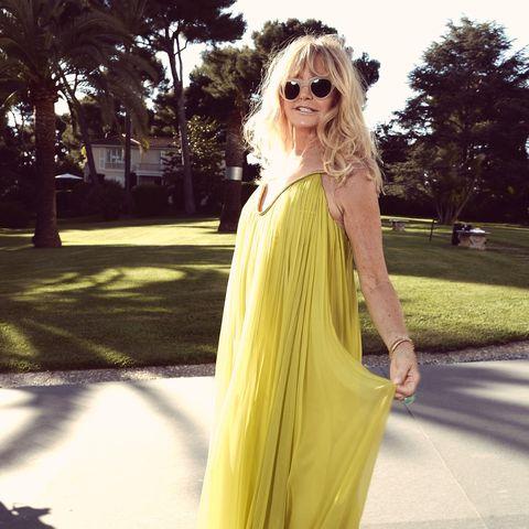 Hair, Clothing, Eyewear, Yellow, Dress, Shoulder, Sunglasses, Fashion, Long hair, Street fashion,