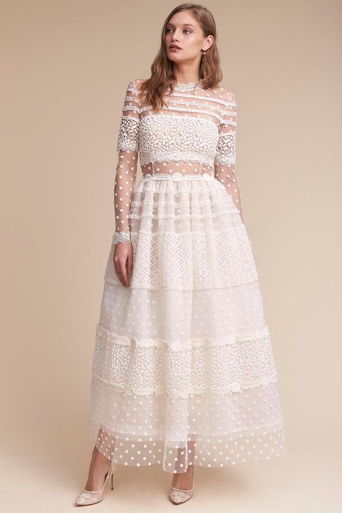 """<p>This Swiss-dot meringue pouf&nbsp;of a dress is also called the&nbsp;""""Keaton."""" So you have to get it.</p><p>$3,600, <a href=""""http://www.bhldn.com/shop-the-bride-wedding-dresses/keaton-gown/productOptionIDS/fbcaeb8b-b90b-4e9a-9313-32da085940dd"""" target=""""_blank"""" data-tracking-id=""""recirc-text-link"""">bhldn.com</a>.</p>"""