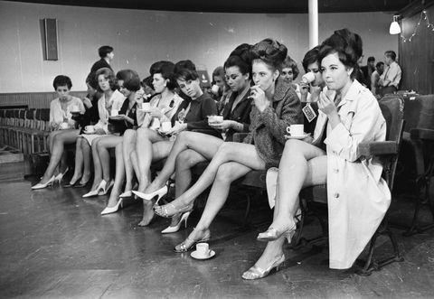 Leg, People, Social group, Monochrome, Photograph, Human leg, Style, Sitting, Black-and-white, Crowd,
