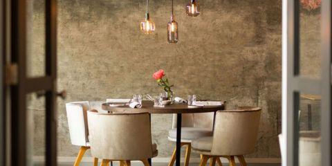 Room, Furniture, Dining room, Table, Wall, Lighting, Interior design, Floor, Light fixture, Wallpaper,