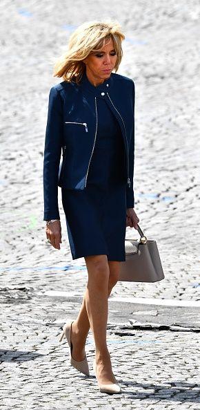 """<p>Presidentsvrouw van Frankrijk.</p><p><a href=""""http://www.harpersbazaar.nl/mode-juwelen/g1358/stylefile-looks-brigitte-macron/"""" target=""""_blank"""" data-tracking-id=""""recirc-text-link"""">Bekijk hier nog veel meer actuele looks van Brigitte</a> &gt;</p>"""