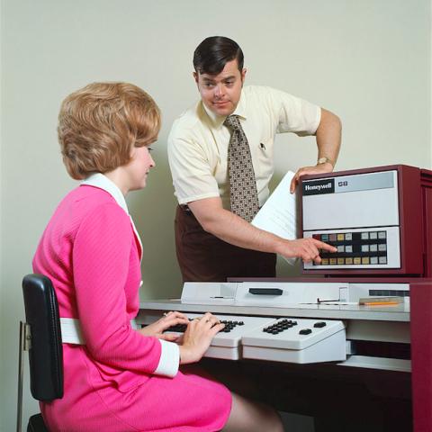 Desk, Job, Office equipment, Furniture, Technology, Electronic device, Employment, White-collar worker, Sitting, Printer,