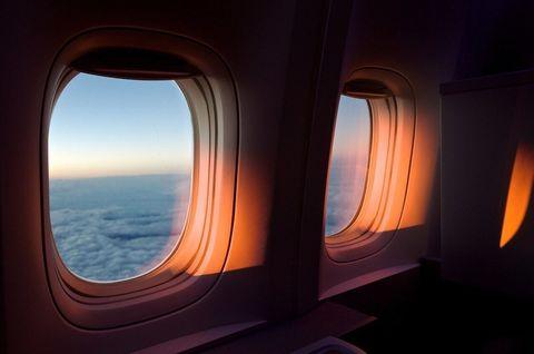 Sky, Light, Orange, Window, Lighting, Room, Porthole, Architecture, Heat, Horizon,