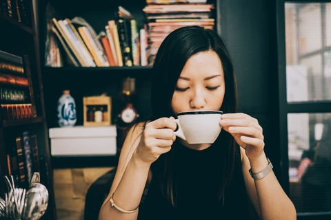 Face, Head, Cup, Lip, Drink, Hand, Cup, Coffee cup, Glasses, Photography,
