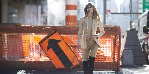 Textile, Outerwear, Coat, Orange, Street fashion, Street, Fashion, Boot, Jacket, Bag,