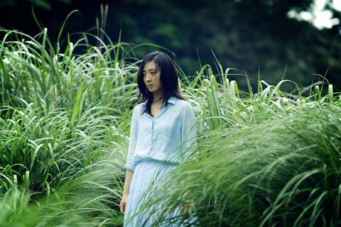 Human, Grass, Green, People in nature, Grass family, Flowering plant, Dress, Black hair, Sunlight, Long hair,