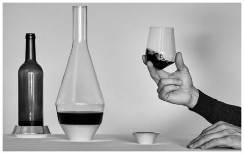 Glass, Drinkware, Bottle, Hand, Barware, Liquid, Black, Glass bottle, Transparent material, Serveware,
