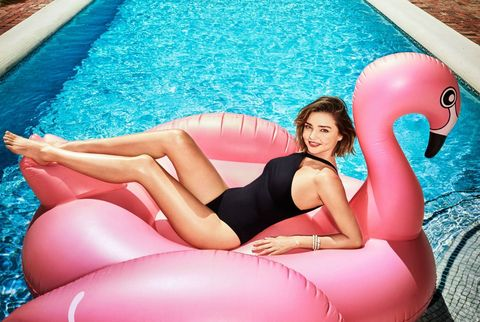 Blue, Human leg, Recreation, Leisure, Comfort, Summer, Aqua, Sitting, Thigh, Swimming pool,