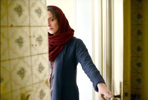 Textile, Wrap, Interior design, Pattern, Stole, Curtain, Maroon, Shawl, Window treatment, Window covering,