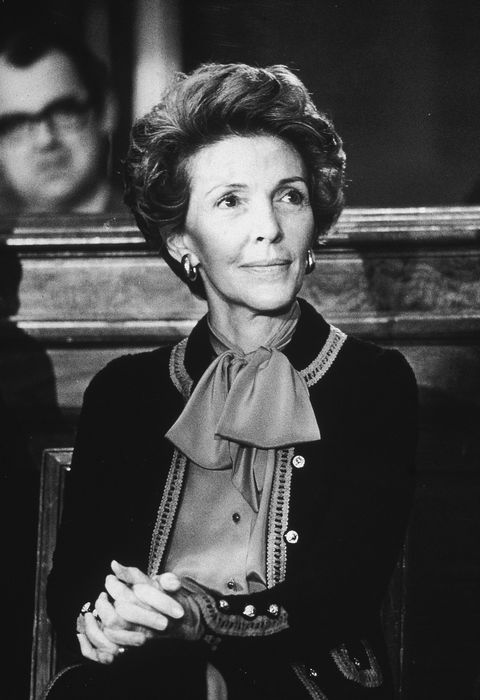 Nancy Reagan, wife of California governor Ronald Reagan, sits with her hands clasped on her knee at the Governor's Press Conference in the Senate Office Building, November 14, 1979. (Photo by Hulton Archive/Getty Images)