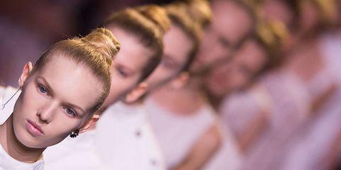 Ear, Hairstyle, Forehead, Eyebrow, Eyelash, Jewellery, Brown hair, Earrings, Blond, Mohawk hairstyle,