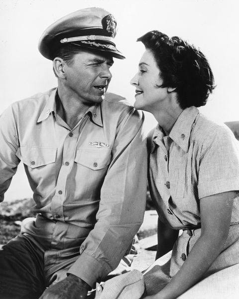 Married American actors Ronald Reagan (1911 - 2004), as Commander Casey Abbott, and Nancy Davis (Nancy Reagan) as Nurse Lt. Helen Blair in 'Hellcats Of The Navy', directed by Nathan Juran, 1957. This is the only film the couple made together. (Photo by Silver Screen Collection/Getty Images)