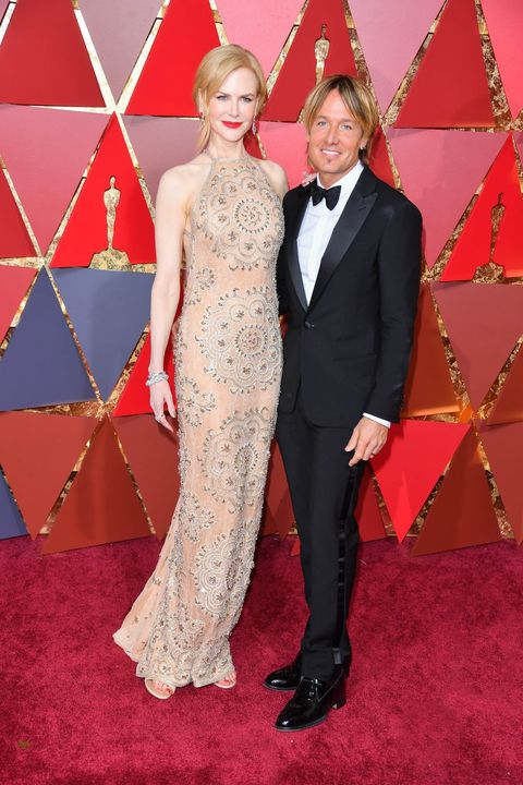 HOLLYWOOD, CA - FEBRUARY 26:  Actor Nicole Kidman (R) and singer Keith Urban attend the 89th Annual Academy Awards at Hollywood & Highland Center on February 26, 2017 in Hollywood, California.  (Photo by George Pimentel/FilmMagic)