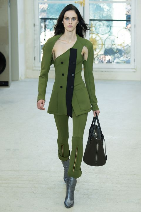 Clothing, Fashion model, Green, Fashion, Coat, Outerwear, Fashion show, Fashion design, Overcoat, Knee,