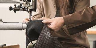 Tailor, Dressmaker, Sewing, Employment, Engineering, Sewing machine, Creative arts, Safety glove, Service, Cuff,