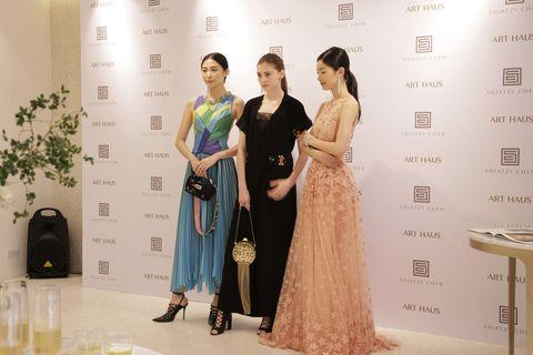 Dress, Trousers, Shoulder, Outerwear, Coat, Flooring, Style, Formal wear, One-piece garment, Fashion,