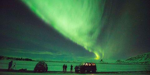 Aurora, Green, Natural landscape, Atmosphere, Atmospheric phenomenon, Night, Space, Horizon, Star, Astronomical object,