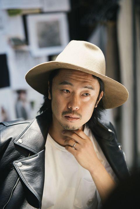 Hat, Jacket, Shirt, Facial hair, Outerwear, Coat, Jaw, Headgear, Street fashion, Sun hat,
