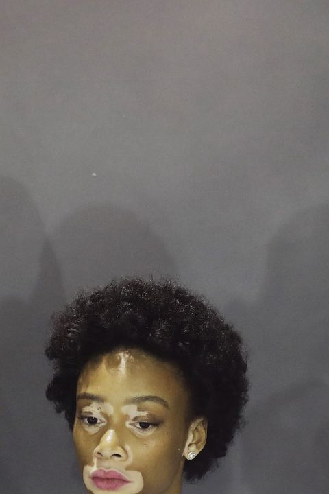 Hair, Face, Hairstyle, Forehead, Head, Afro, Eyebrow, Jheri curl, Nose, Chin,