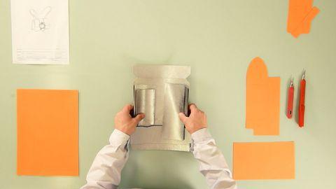 Orange, Room, Hand, Small appliance, Interior design, Table, Furniture,