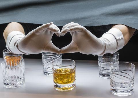 Water, Yellow, Glass, Drinkware, Alcohol, Pint glass, Hand, Drink, Barware, Shot glass,