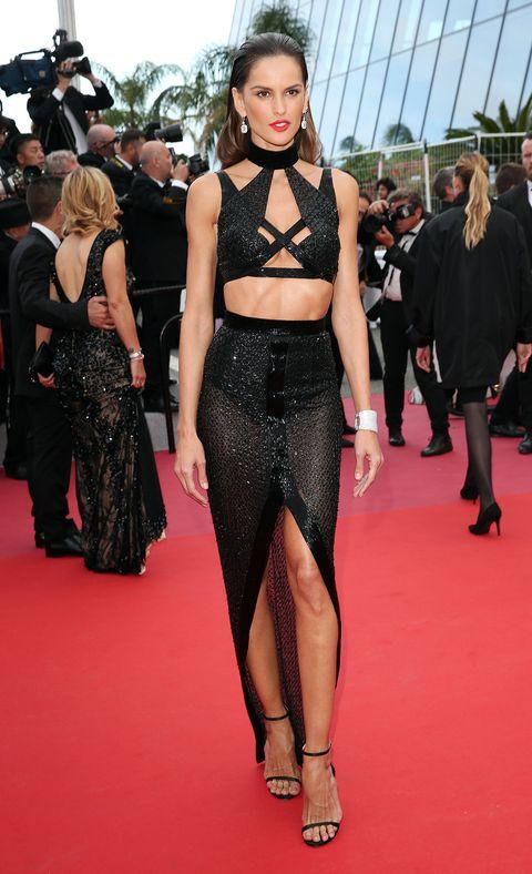Fashion model, Red carpet, Clothing, Carpet, Fashion, Flooring, Premiere, Dress, Waist, Crop top,