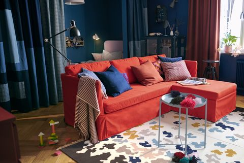 Furniture, Living room, Couch, Room, Interior design, Blue, Red, Curtain, Property, Table,