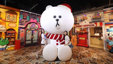 Bear, Teddy bear, Stuffed toy, Toy, Mascot, Interior design, Tourism, Plush, Games,