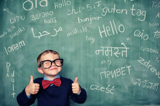 a young language master boy knows how to say hello in many different languages all languages and cultures are beautiful