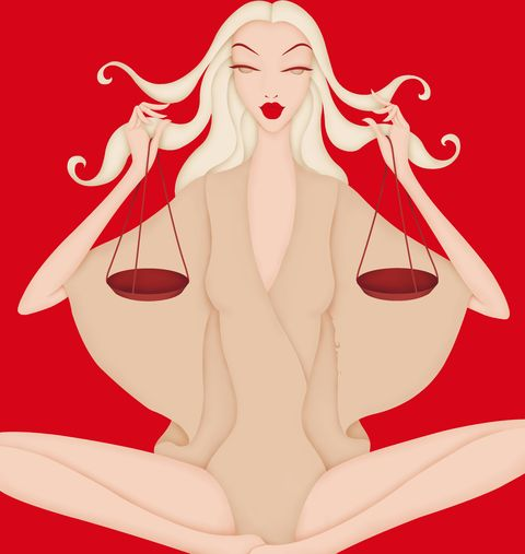 beautiful woman holding scales posing as astrology sign libra